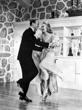 Fred Astaire and Ginger Rogers with Trophies on Cabinet by Movie Star News