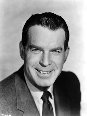 Fred MacMurray smiling in Black Classic Portrait by Movie Star News