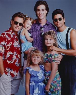 Full House Cast Posed in Blue Background by Movie Star News