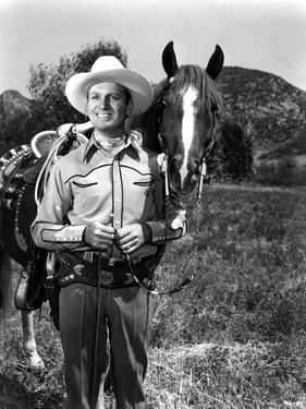 Gene Autry smiling in Photo by Movie Star News
