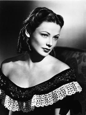 Gene Tierney Posed in Black Dress with Dark Background by Movie Star News
