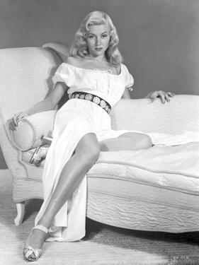 Gloria Grahame Leaning on Couch in White Dress by Movie Star News