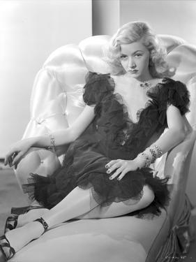 Gloria Grahame Posed on Couch wearing a Black Dress by Movie Star News