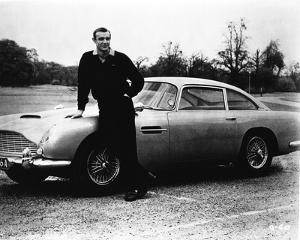 Goldfinger Bond Leaning on Car wearing Black Long Sleeves by Movie Star News