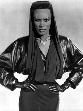 Grace Jones wearing Black Gown with Black Gloves by Movie Star News
