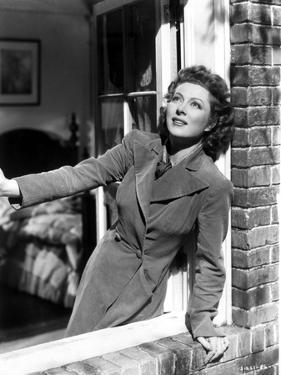 Greer Garson on a Long Sleeve Coat Leaning on a Window by Movie Star News