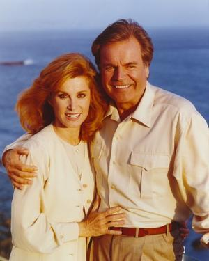 Hart To Hart Man and Woman in a Long Sleeve Top Embraced by a Man by Movie Star News