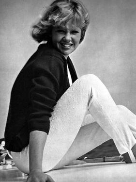 Hayley Mills sitting in a Black Blouse with Hands on Side by Movie Star News