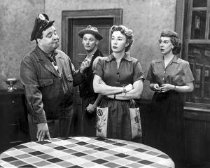 Honeymooners Lady Crossing Arms on Abdomen and Sheriff Talking by Movie Star News