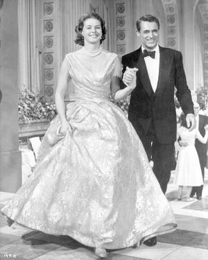 Indiscreet Woman in Dress and Man in Black Suit Walking by Movie Star News