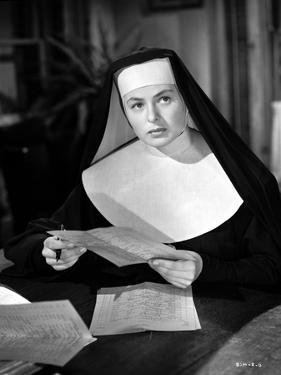 Ingrid Bergman Reading in a Nun Attire by Movie Star News