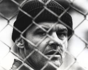 Jack Nicholson in Crochet Hat Behind the Wire Fence by Movie Star News