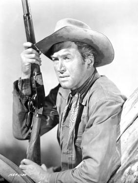 James Stewart Posed in Leather Jacket and Neckerchieft with Cowboy Hat while Holding a Sawed-Off Sh by Movie Star News
