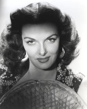 Jane Russell Close Up Portrait in Black Floral Dress with Straw Hat in White Background by Movie Star News