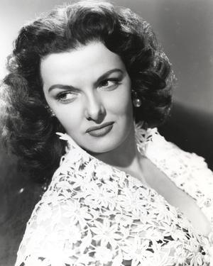 Jane Russell Portrait in White Floral Lace Dress while Leaning Back and Looking to the Right by Movie Star News