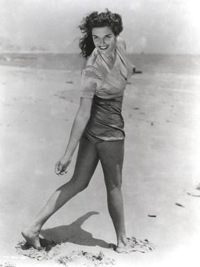 Jane Russell Posed in Silk Short Sleeve Shirt and Shorts while Walking on the Beach Sand by Movie Star News