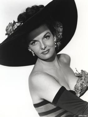 Jane Russell Posed in Stripe Strapless One Piece Swimsuit and Black Broad Straw Hat by Movie Star News