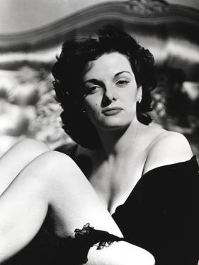 Jane Russell Seated on the Bed in Black Silk Robe with Knees Bent and Arms Crossed Around the Legs by Movie Star News