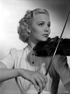 Jane Wyman Playing Violin in Classic by Movie Star News