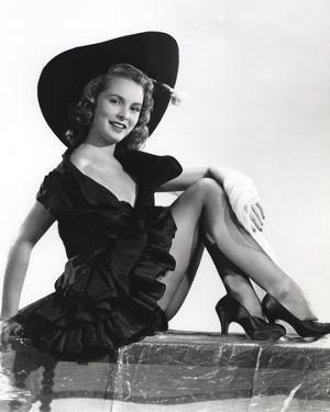 Janet Leigh Reclining on the Table in Black Sleeveless V-Neck Silk Dress by Movie Star News