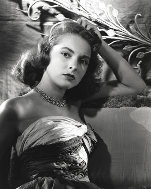 Janet Leigh sitting on the Couch in Strapless Gatherer Bodice Shoulder Dress by Movie Star News