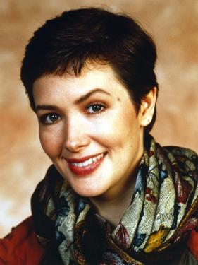 Janine Turner Portrait in Floral Scarf by Movie Star News