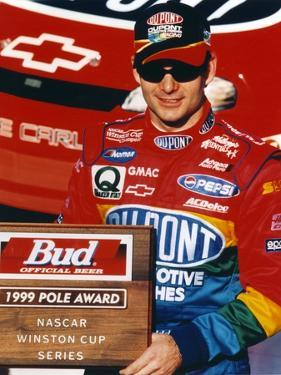 Jeff Gordon Posed in Black Ball cap and Red Overalls by Movie Star News