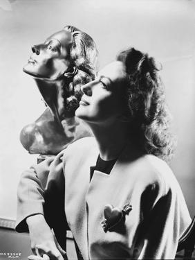 Joan Crawford Looking Up Like the Statue in a Classic Portrait by Movie Star News