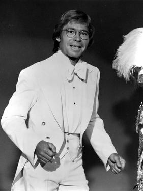 John Denver in White Suit With Black Background by Movie Star News