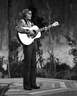John Denver Playing Guitar by Movie Star News