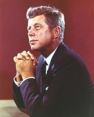 John Kennedy Pose in Black Suit by Movie Star News
