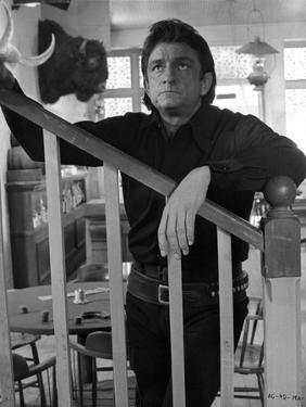 Johnny Cash Leaning on Stair by Movie Star News