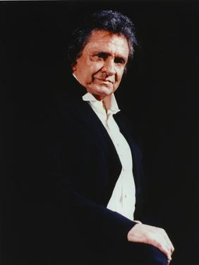 Johnny Cash wearing a Black Suit with White Undershirt by Movie Star News