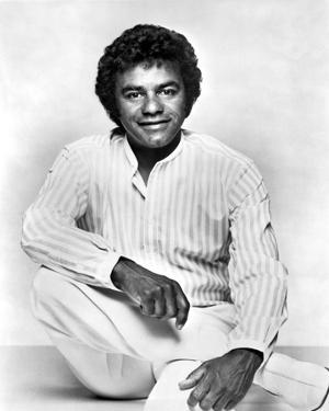 Johnny Mathis in White With White portrait by Movie Star News