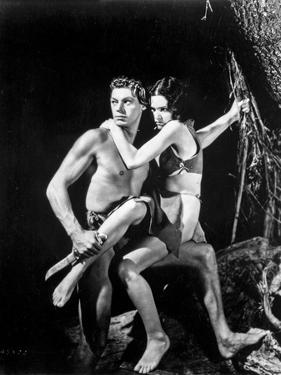 Johnny Weissmuller Carrying a Girl in a Movie Scene by Movie Star News