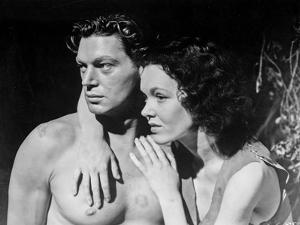 Johnny Weissmuller Hugged by a Woman in a Movie Scene by Movie Star News