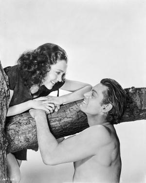 Johnny Weissmuller Talking to a Woman on Top of a Tree in a Classic Movie Scene by Movie Star News