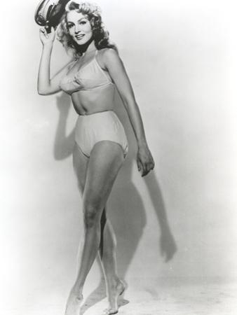Julie Newmar Holding Hat in Lingerie Black and White by Movie Star News