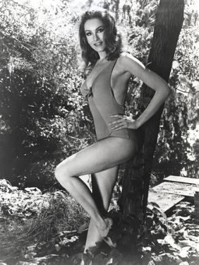 Julie Newmar Leaning on Tree in Lingerie Outfit by Movie Star News