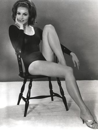 Julie Newmar Siting on Chair in Black Dress by Movie Star News