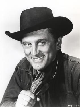 Kirk Douglas smiling in Cowboy Outfit by Movie Star News