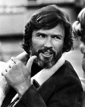 Kurt Kristofferson Talking in Black Suit by Movie Star News