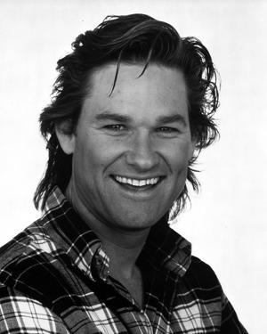 Kurt Russell Posed in checkered polo shirt With White Background by Movie Star News