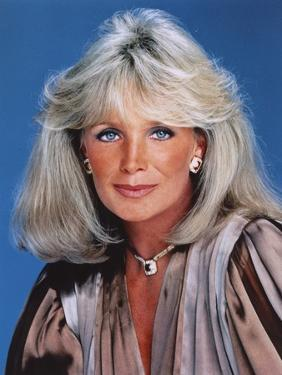 Linda Evans Blue Background Close Up Portrait by Movie Star News