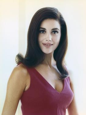 Linda Harrison Posed in Red Dress by Movie Star News