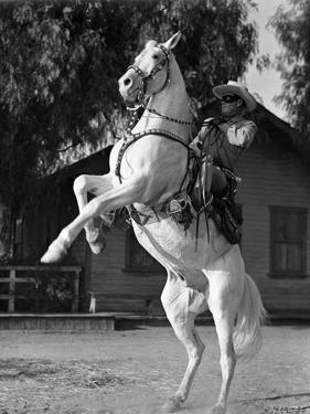 Lone Ranger Riding a Horse, wearing a Cowboy Attire by Movie Star News