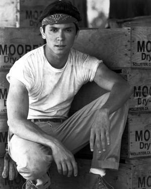 Lou Phillips in White TShirt With Headband by Movie Star News