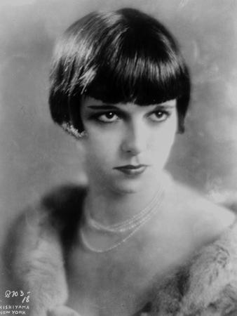 Louise Brooks Posed in Fur Coat with Necklace and Earrings