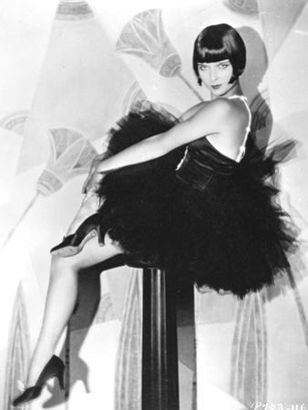 Louise Brooks sitting in Black Dress with Black Heels