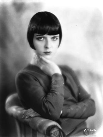 Louise Brooks sitting in Sweater with Hands on Neck Portrait